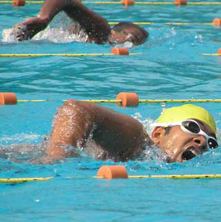 2 swimmers competing in swimming event